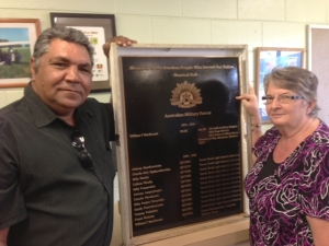 AURUKUN MAYOR DEREK WALPO AND LINDA SIVYER WITH THE MEMORIAL PLAQUE