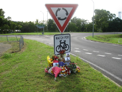 FLORAL TRIBUTES AT SCENE OF AN EARLIER BICYCLE FATALITY - COURTESY www.cairnsbug.org